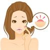 生理前のニキビや吹き出物に悩む女性
